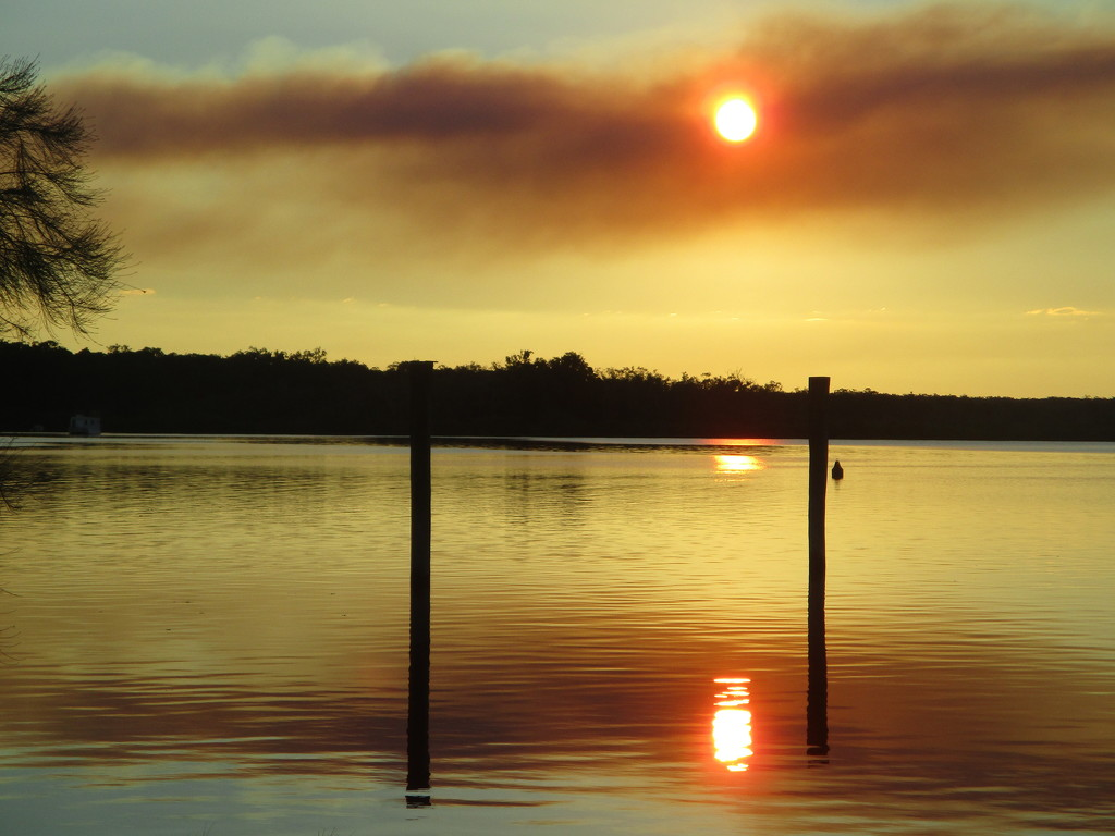 Sunset at Tin Can Bay through smoke haze by 777margo
