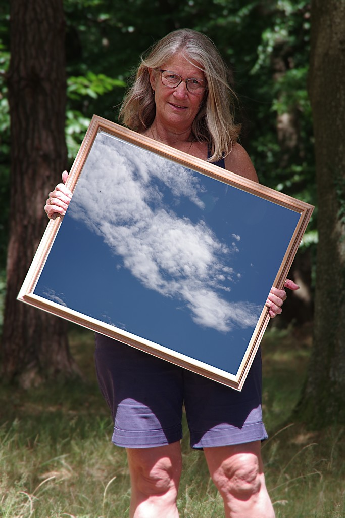 Scudding Clouds Reflecting in A Frame by thedarkroom