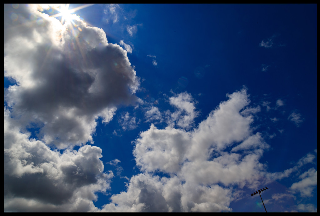 Clouds and Sunburst by hjbenson