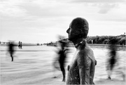 22nd Aug 2020 - I was taking a shot of the statue when some children ran past. I had a slow shutter speed as it was really windy and the sand was blowing high so it made this different image of the statue.