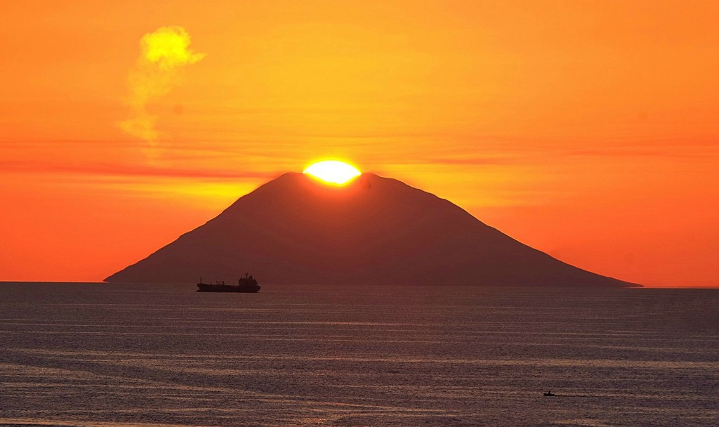 Sun setting in the volcano by caterina