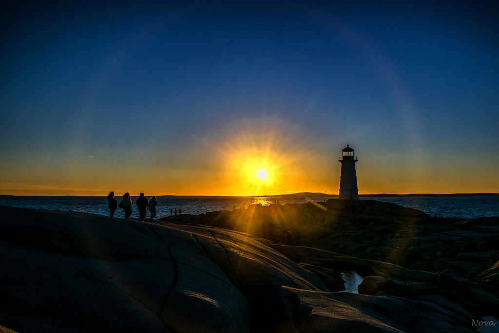 Lens flare at Peggy's Cove by novab