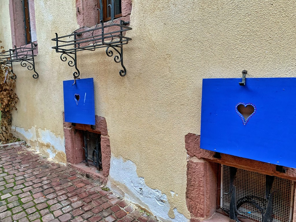Hearts on blue shutters.  by cocobella