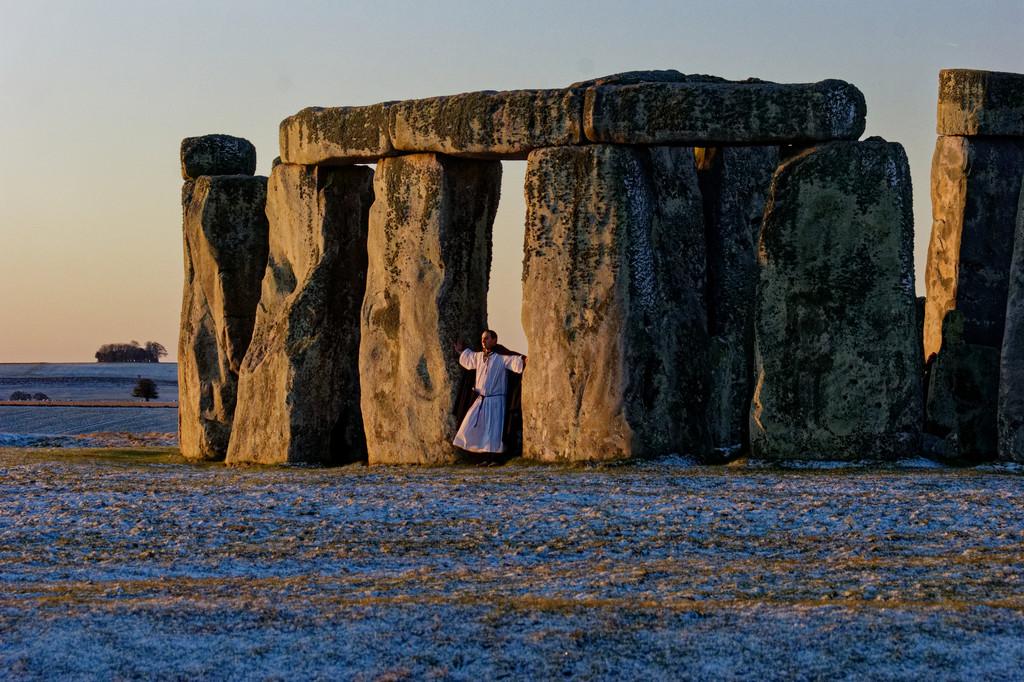 0915 - Druid welcoming sunrise at Stonehenge by bob65