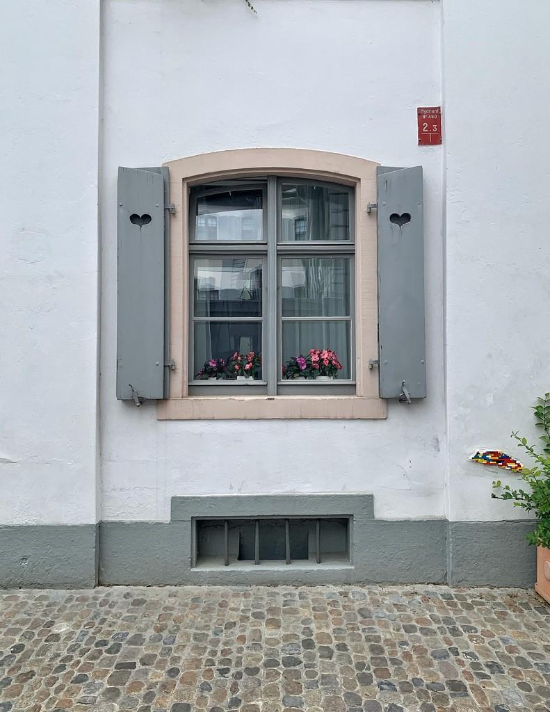 Hearts on grey shutters.  by cocobella