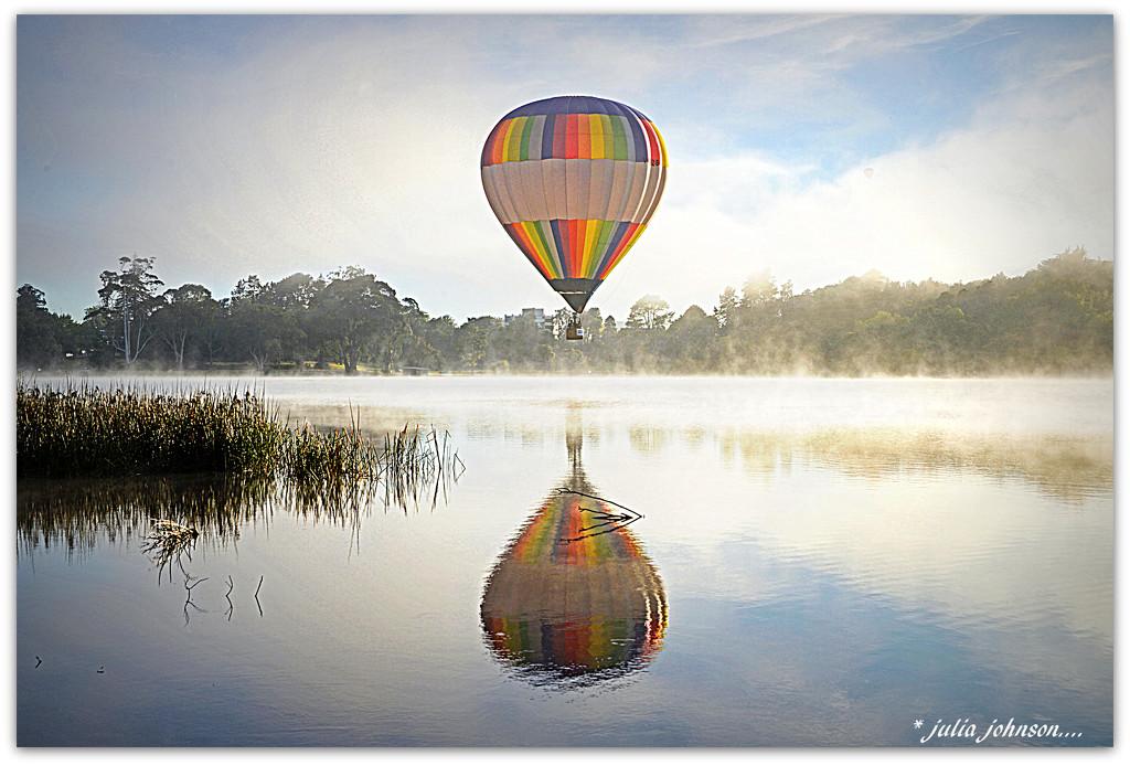 Balloon over lake by julzmaioro