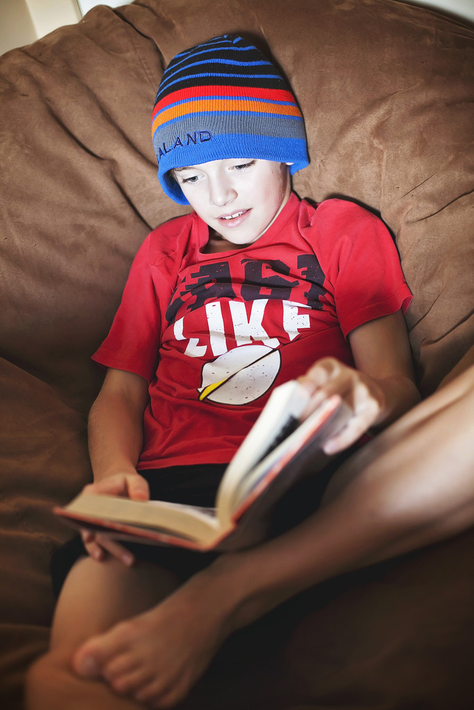 Reading on his beanbag by kiwichick