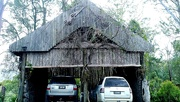 26th Sep 2020 - Wooden garage made by a carver