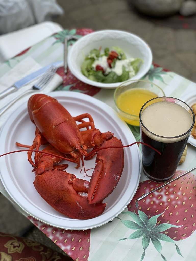 Patio lobster party amid rain showers by berelaxed
