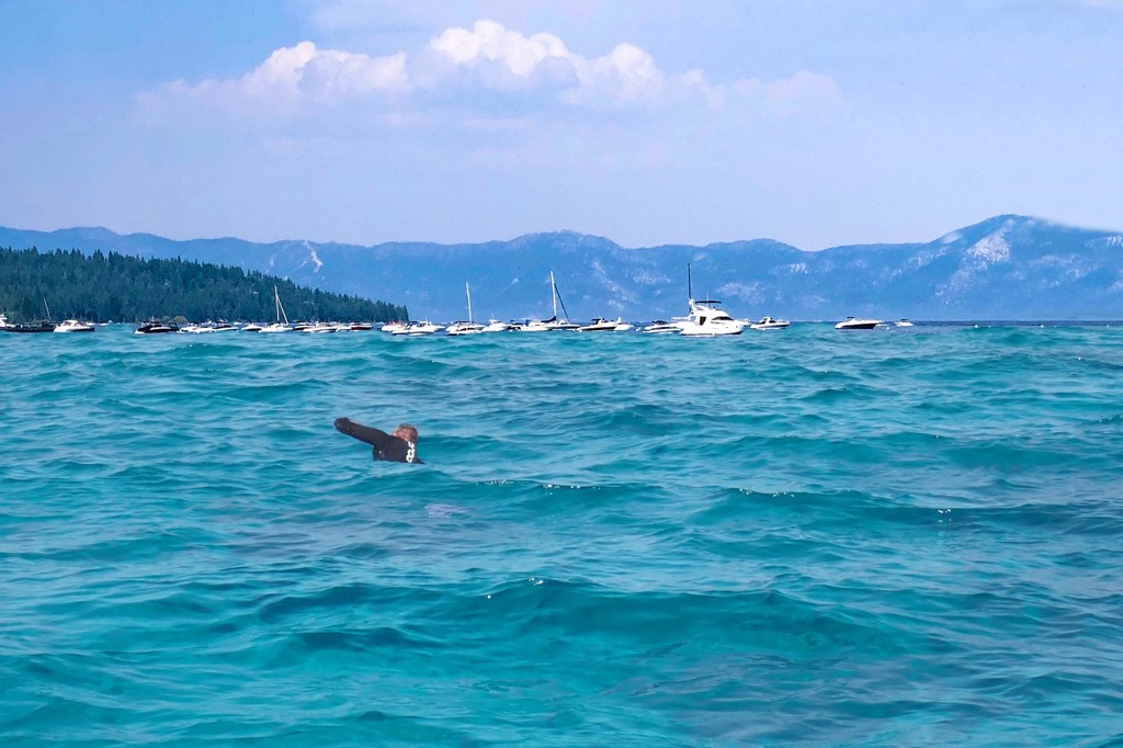 Swimming back to the boat by shutterbug49