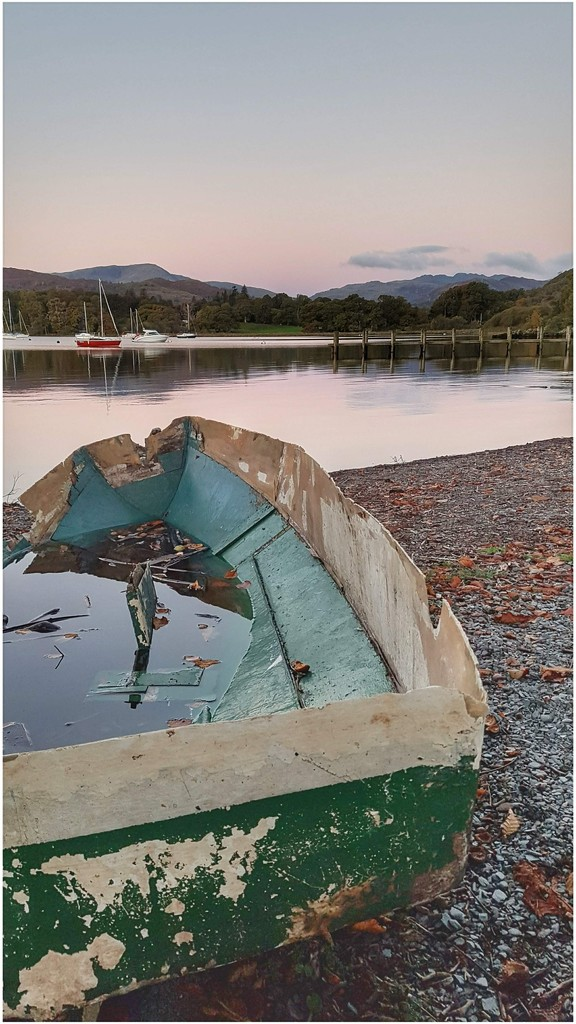 Sunrise at Ambleside in the Lake District - the boat has seen better days! by lyndamcg