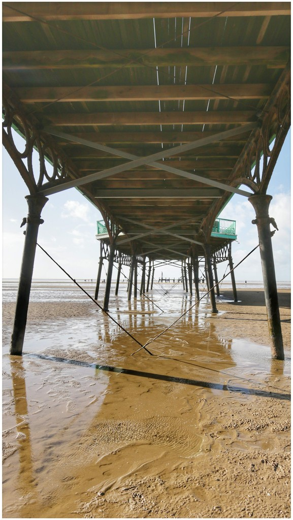 Under the pier - and you can see the old pier remains at the end by lyndamcg