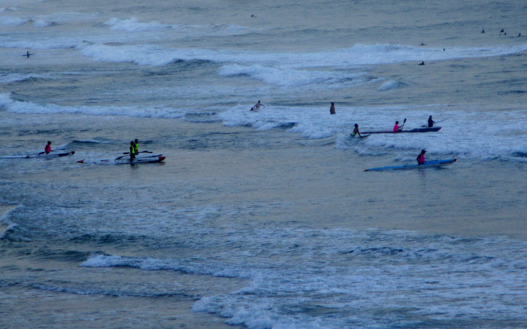 Surfers all waiting for the big wave by 777margo