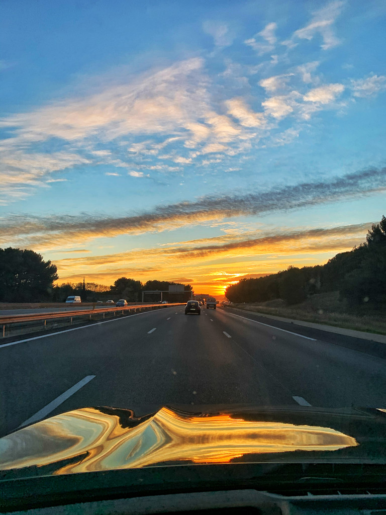 Sunset on my car.  by cocobella