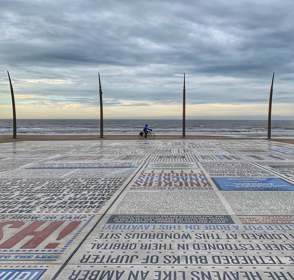 The comedy carpet & lone cyclist. by happypat
