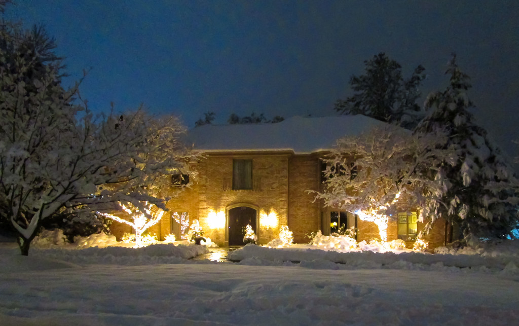 Decorated house with snow by mittens
