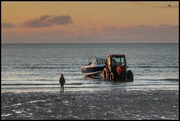 7th Jan 2021 - Loved this shot of the child watching the fishing boat being brought in - he was mesmerized!