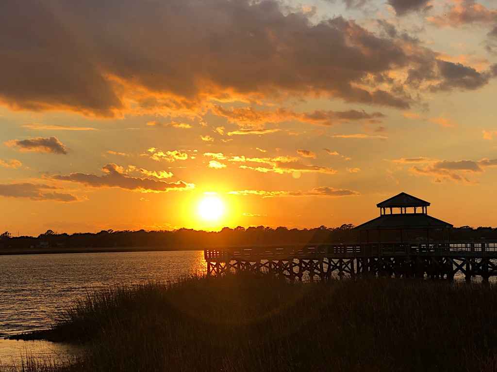 Sunset over the Ashley River at Brittlebank Park by congaree