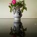 Rosebuds in vase.