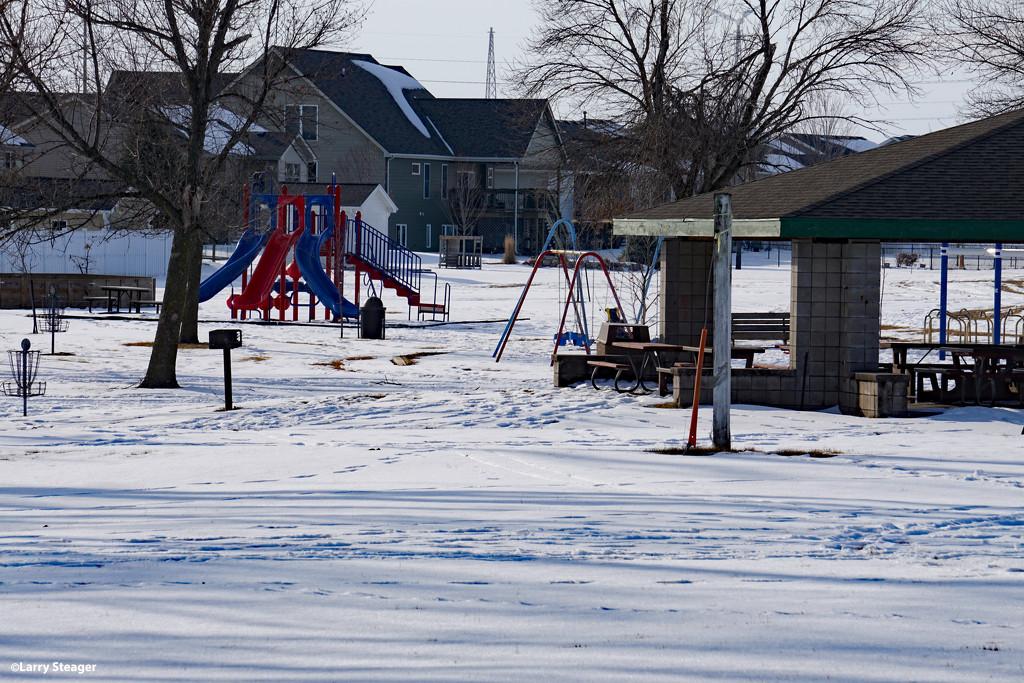 Snow bound park by larrysphotos