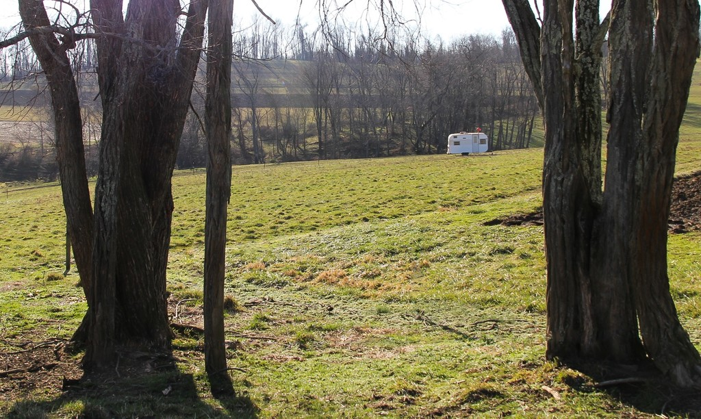 Camper in the field by mittens