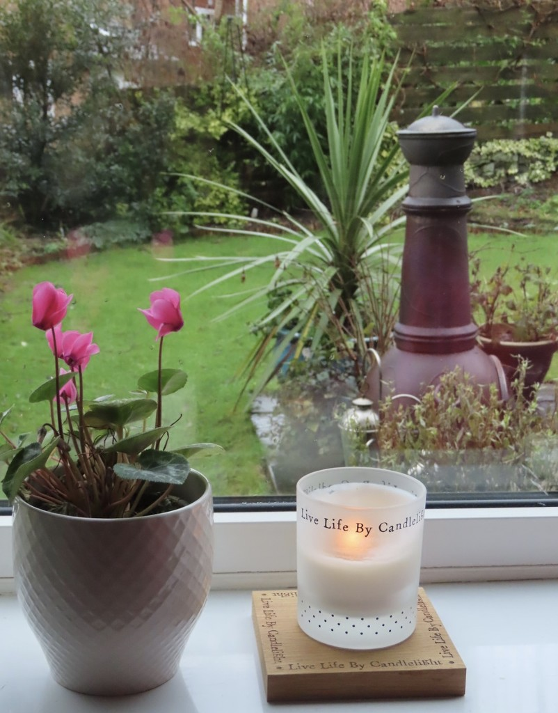 A candle is just right on a gloomy day by dawnmoody