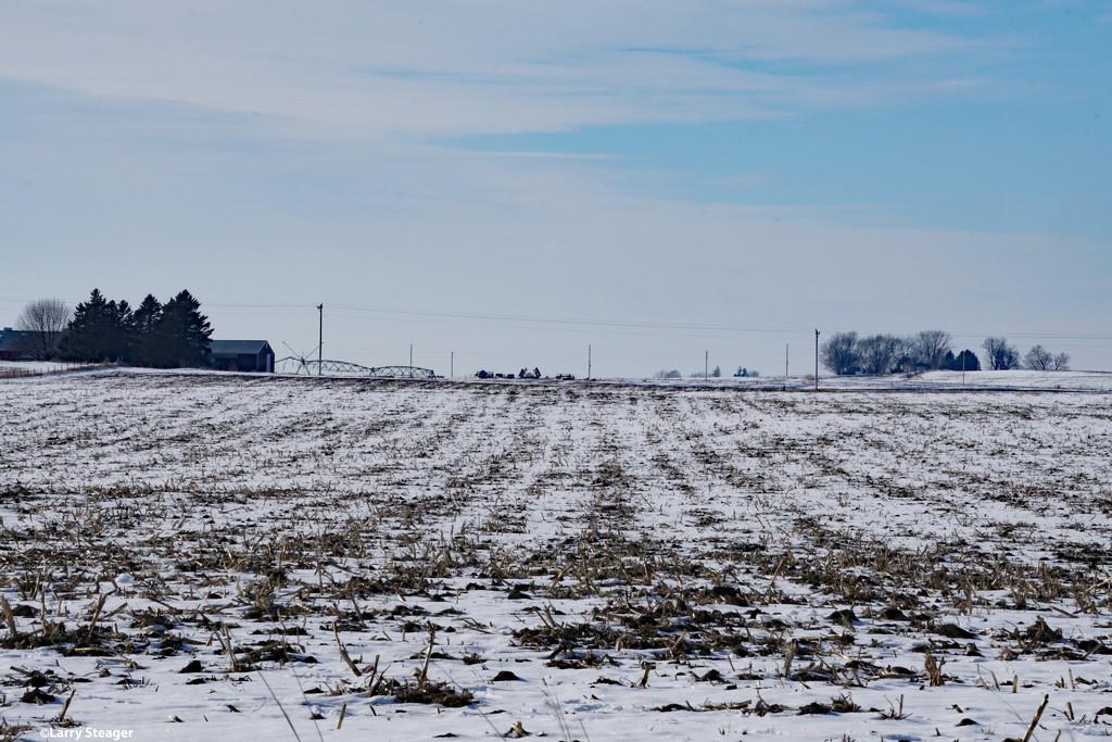 Farm land on a cold January day by larrysphotos