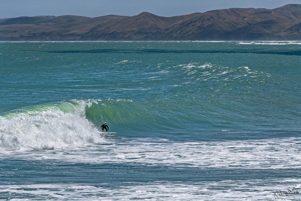 Surfing at Manu Bay by nickspicsnz