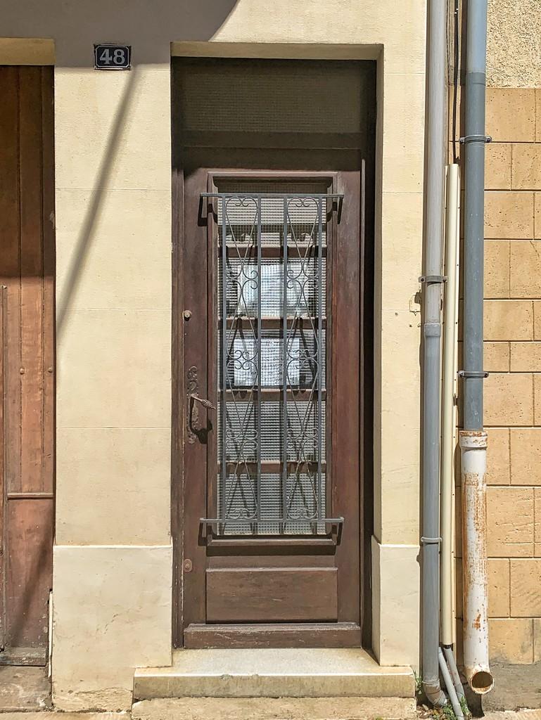 Hearts on brown door.  by cocobella