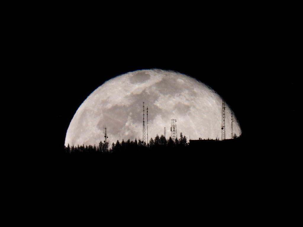 Moonrise behind Radio Towers by janeandcharlie