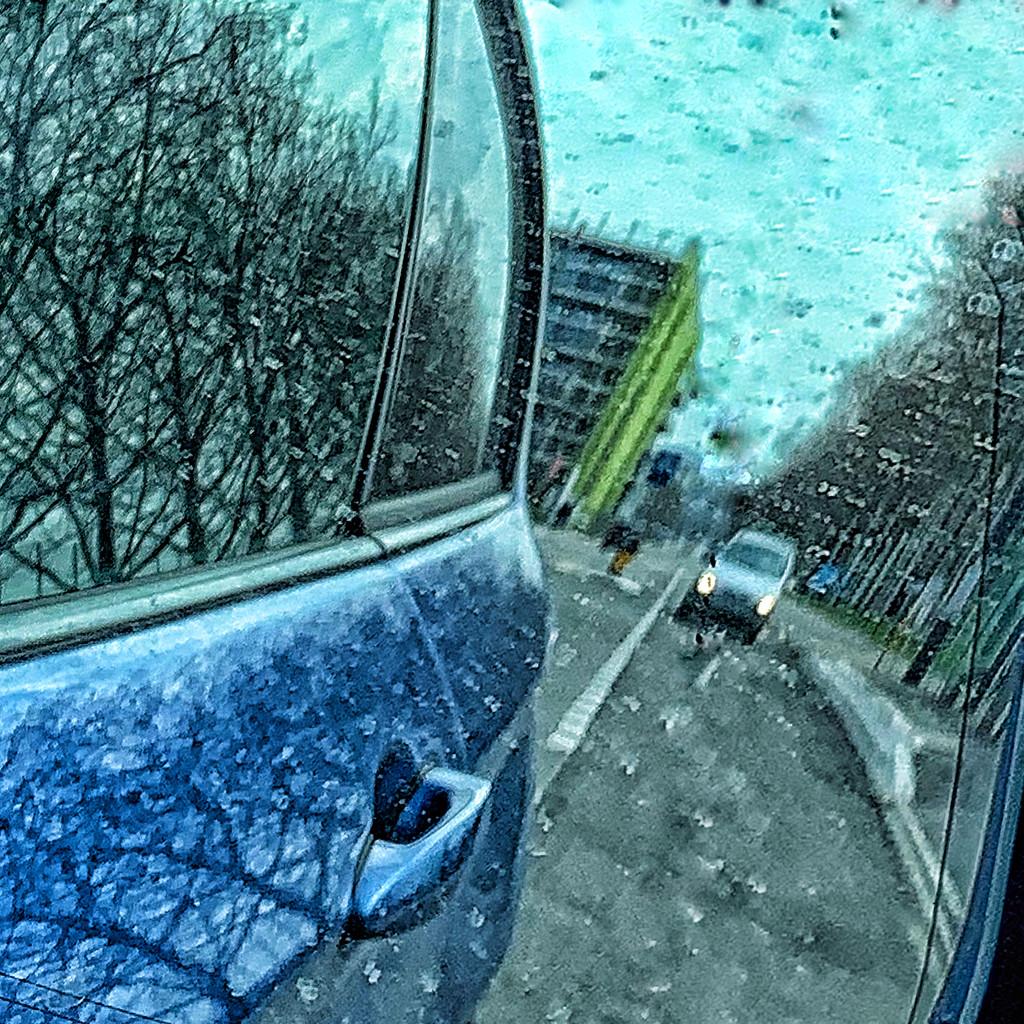 Half car / half street.  by cocobella