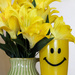 Yellow Smiley Cup and flowers by mittens
