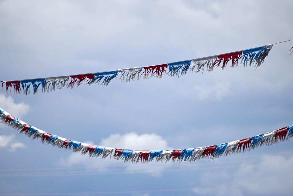 Fluttering Flags At Don Aadsen Ford Dealer by bjywamer
