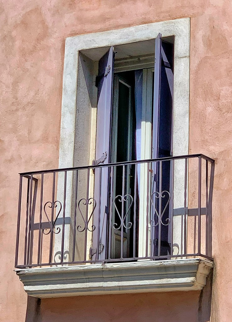 Four hearts on a balcony.  by cocobella