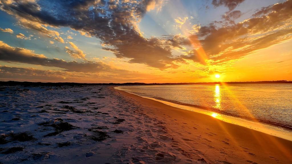Sunset Over the Beach by photograndma