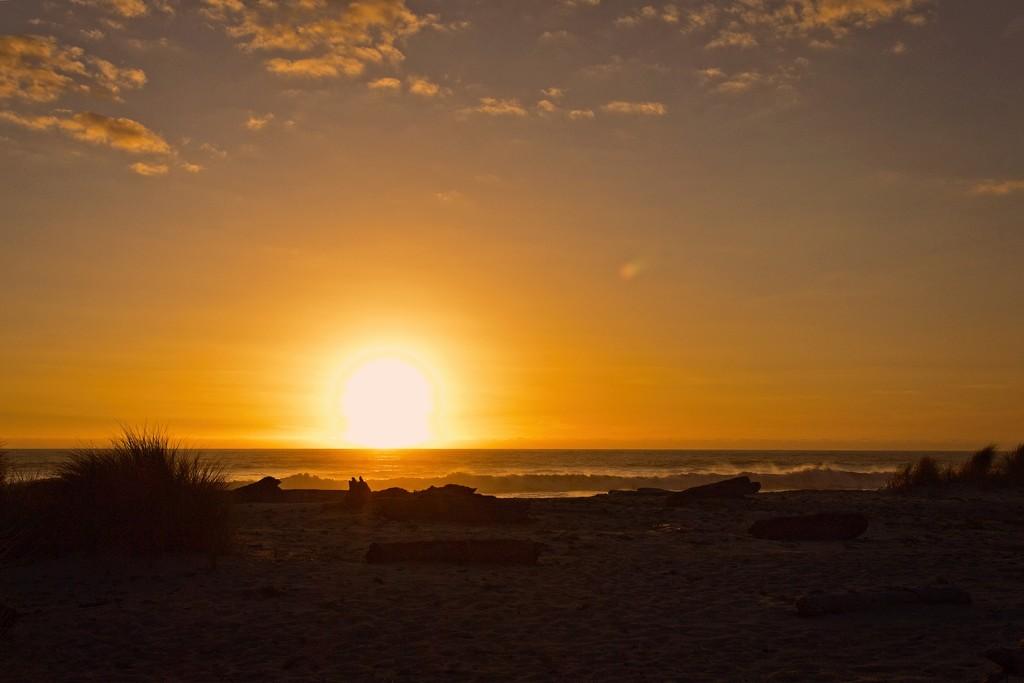 Setting sun at Kohaihai, Karamea  by kiwinanna