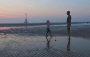20th Apr 2021 - This little girl was dancing around the statue so used a slow shutter speed to blur her!