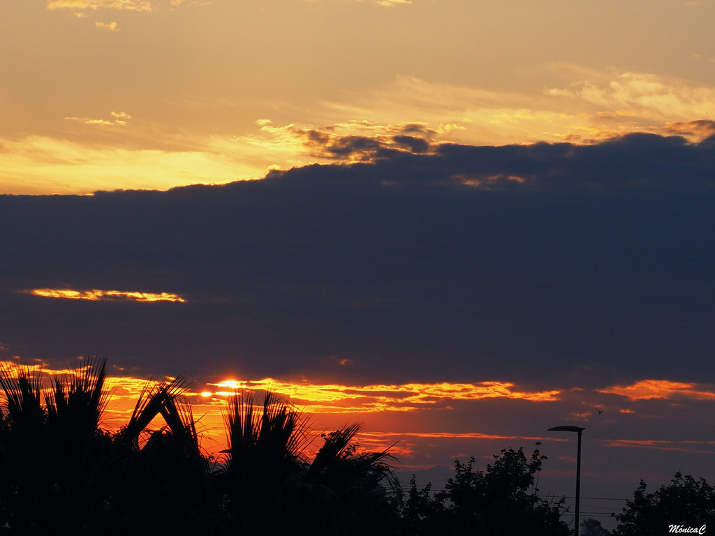 Sun rising behind the clouds by monicac