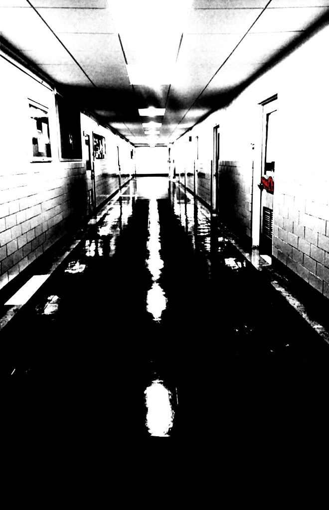 Hallway in B&W (and a touch of red) by mcsiegle