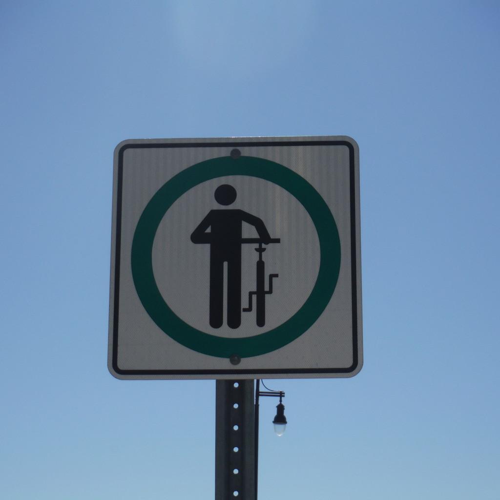 Signs #1: Cyclists Dismount (?) by spanishliz
