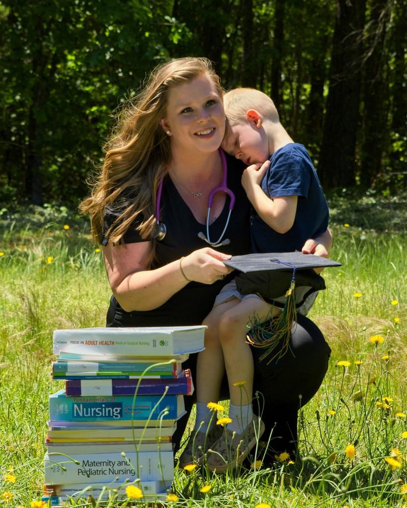 LHG-0644- Nursing Grad with her child by rontu