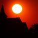 The Sun over a church by j_kamil