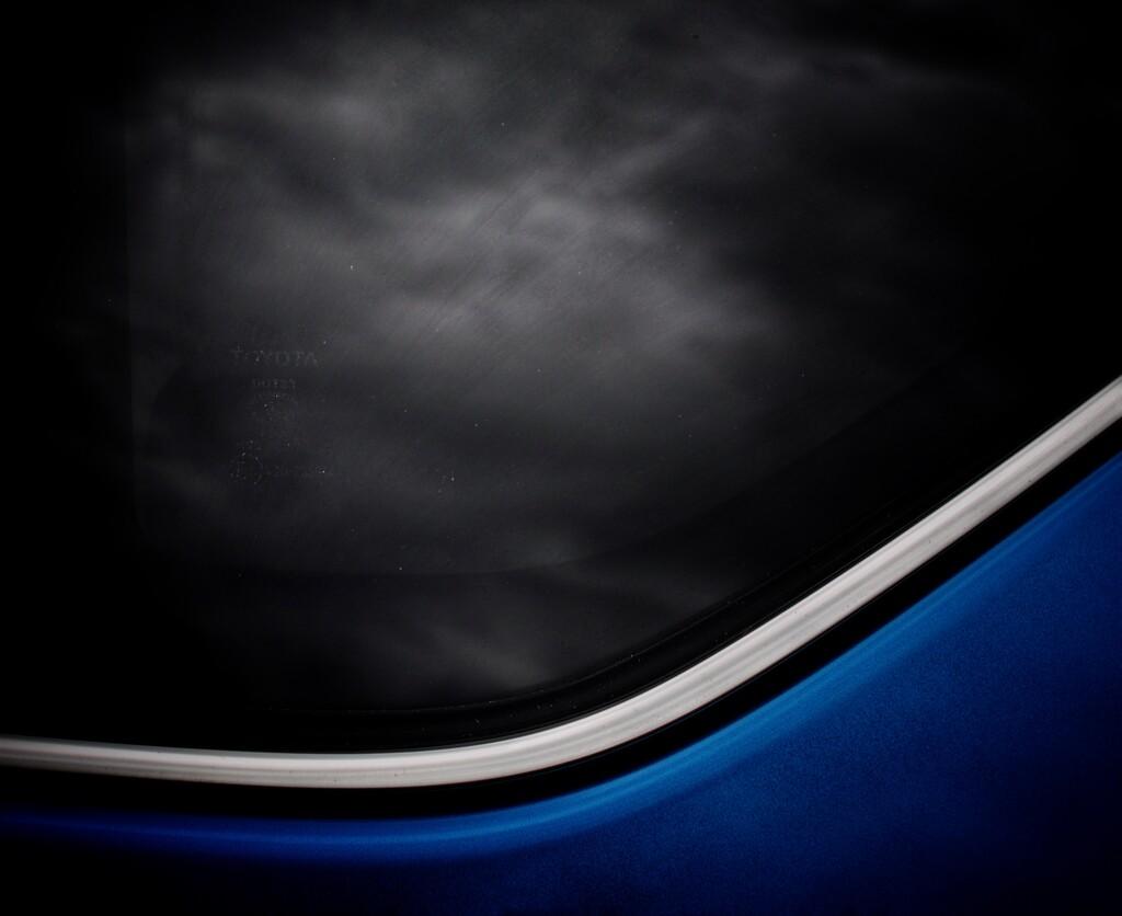 Clouds in the car window by joemuli
