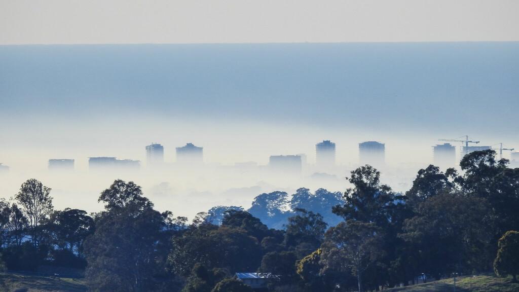 Maroochydore in fog by jeneurell