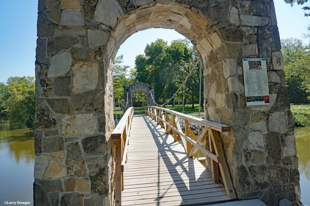 Swinging Foot bridge by larrysphotos