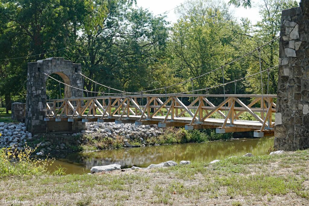 Bridge over still water by larrysphotos