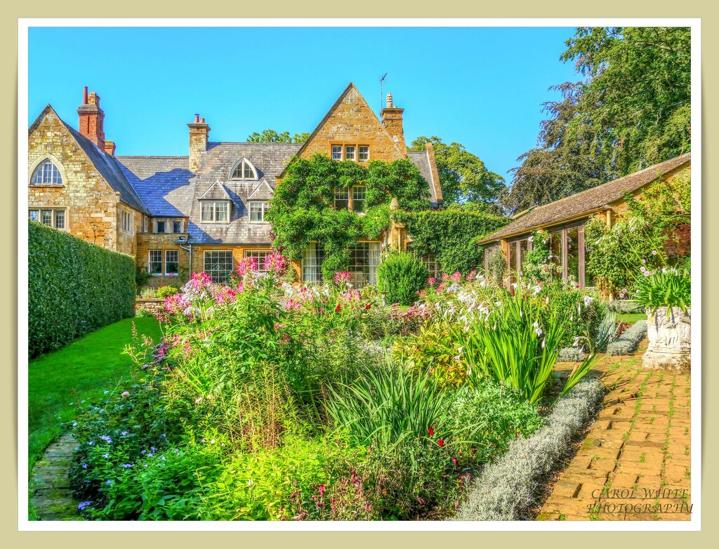 Coton Manor In Autumn Sunshine by carolmw