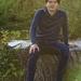 Micah sits on a stump